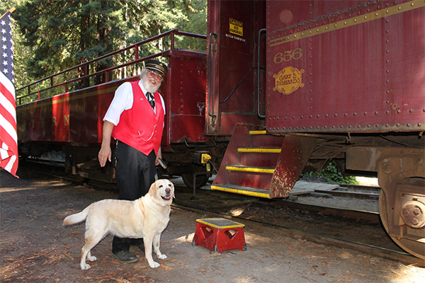 Kayla and Chuck the conductor boarding the Skunk Train