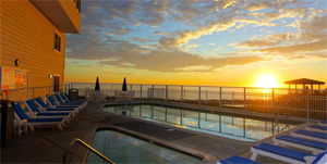 sunset over pool at Pismo Beach Lighthouse suites