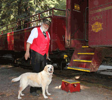 Kayla the lab and Chuck the conductor prepare to board the Skunk Train