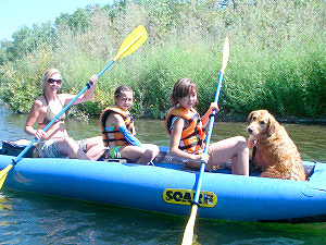 Kids and dog in raft on Russian River